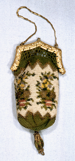 Small purse of crocheted silk and gold thread in green, white, red and faded yellow in pattern of flower clusters. Green saw tooth border at top and bottom. Set into a gold frame at top with catch to close. Fine gold chain for carrying.
