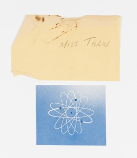 Print with blue background and white atomic symbol.