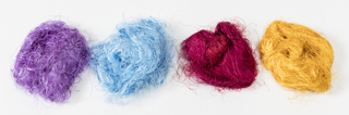 Loose overstock silk yarn in various colors.