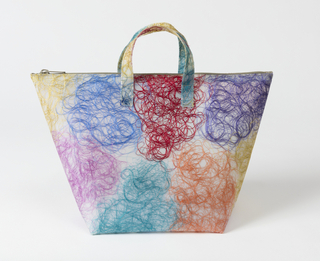 Tote bag with multicolored silk thread waste embedded in polyurethane.