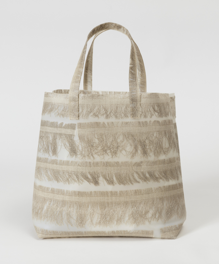 Tote bag with natural linen selvedges embedded in polyurethane.