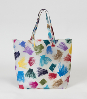 Tote bag with multicolored pieces of cut silk selvedges embedded in polyurethane.