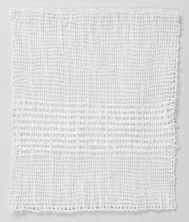 A white four-sided selvage textile loosely woven with striped pattern on the bottom half.
