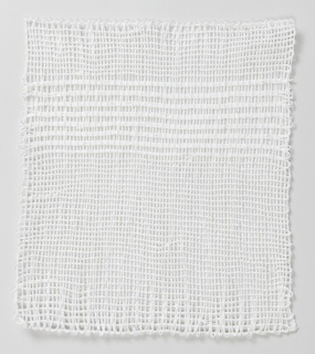 A white four-sided selvage textile loosely woven with striped pattern on the top half.