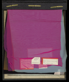 Sample book with thirty-six samples of textiles made by the American Viscose Company. Each sample has an information label attached on quality and use of the textiles.
