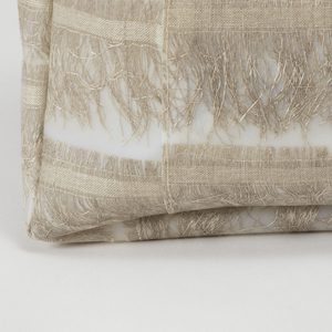Tote bag with stripes of natural linen selvedges embedded in polyurethane.