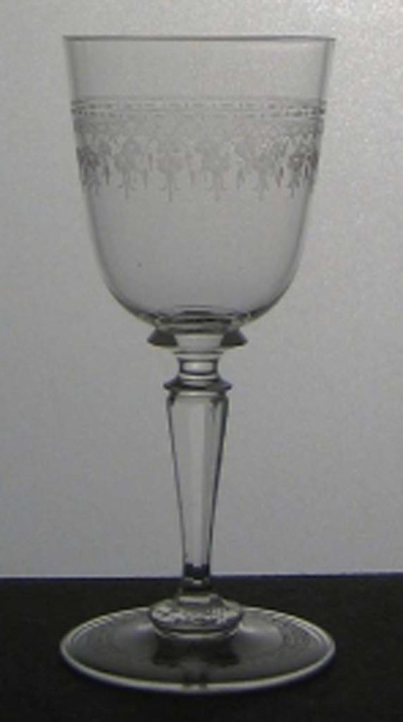 Mouth-blown crystal, partly facet-cut and polished, with a dainty floral engraved border