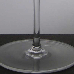 Thin mouth-blown glass, bowl slightly incurved toward lip on thin stem and circular foot