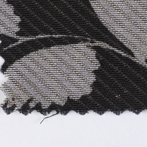 Black ground with printed lilac colored leaves, woven diagonal gold metallic stripes.