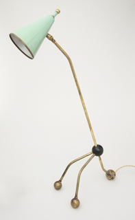 Articulated three-legged table lamp with ball feet and conical shade
