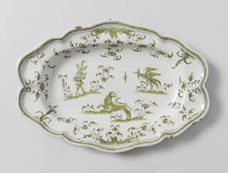 Oval platter with scalloped edges. Thin magnesium outlines filled with green show flora and fauna decoration, and three figures in center.