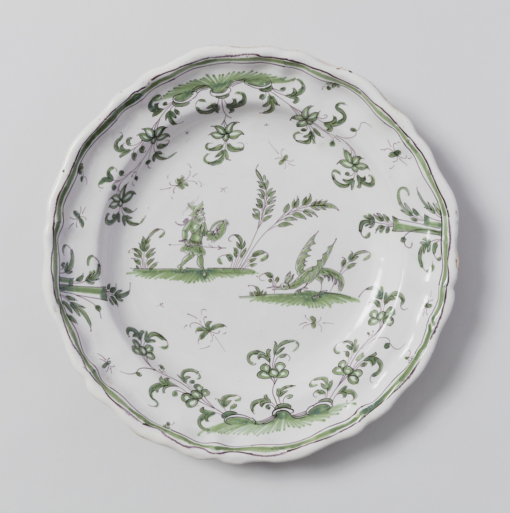 Circular plate with scalloped edge; pale green floral decoration around perimeter, fauna and figure in center.