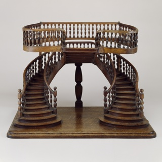 "Double-revolution staircase model with curved double staircase with baluster railings, joining on a central landing from which a reverse single staircase rises at right angles, leading to a balcony; this staircase model is similar to one described as being ""in Renaissance style for a store"", in plate 17 of a folio by E. Delbrel, published in Paris in the 1880's."