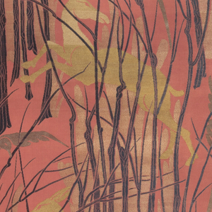 Forest scene formed by staggered repeats of grouped black leafless saplings with gold leaping gazelles and silver birds on soft, dark orange satin ground.