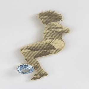 Brooch in form of soccer player kicking a ball; made from laminated newspaper image applied to brooch surface; ball consists of circular acquamarine.