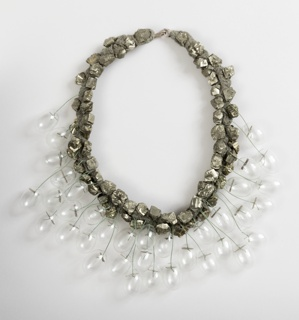 Necklace comprising chunks of pyrite threaded with small, clear glass lightbulb-like globes.