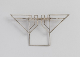 Brooch consisting of thin segments forming angled and rectilinear geometric shapes.