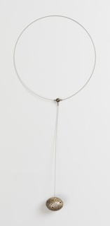 Perforated silver orb on cord hanging from circlet.