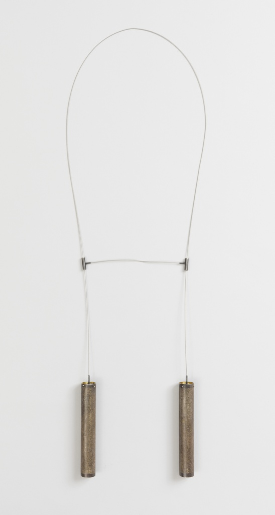 Necklace with two pendant tubes of perforated gold.