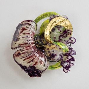 Polychrome flower-form brooch.