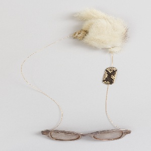 Silver plated glasses on a chain with snakeskin and small piece of tan fur.