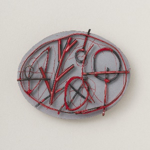 Oval wooden brooch, red and grey paint.