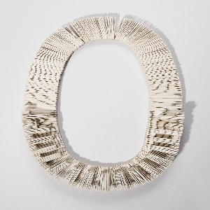 Handmade thick paper strips strung together to form flexible necklace. Some strips cut into rectilinear shapes.