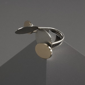 Finger ring with four projecting circles of different colors (silver/gold).