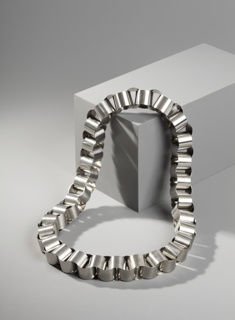 Circular form of interlocked cylindrical steel links.
