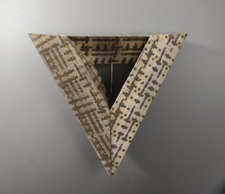 Triangle-shaped brooch formed of a fusion of fragments of different metals