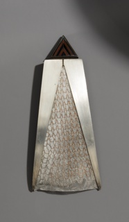 Triangular brooch, silver chevron and mesh.