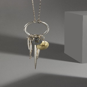 "Necklace that hangs at 30""; features a ring with attached hanging pendants."