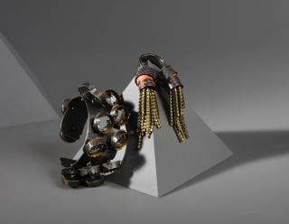 Cuff bracelet with loosly applied circular mirrors.
