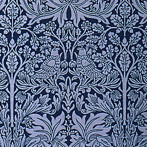 Length of printed cotton with a pairs of rabbits and birds mirrored around vertical columns of stylized foliage. Design in reserved white on a deep blue ground.