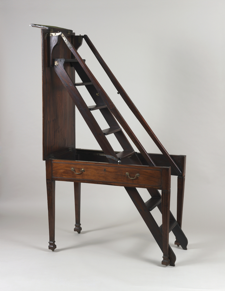A four-legged rectangular table made in mahogany with brass handles. This table folds out into a small ladder.