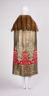 Mink and silk cape with pâte de verre beaded pagoda and arboreal decoration.