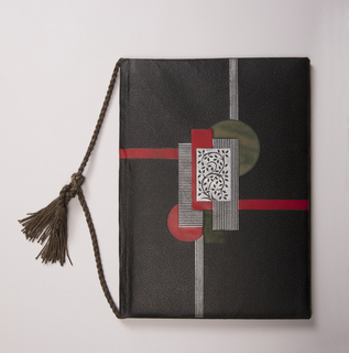 Black leather-bound photograph folio, with abstract, geometric design in colors red and silver tooled on cover, with central floral motif; gold silk band with tassels; and silver interior.