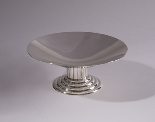 """Footed, wide shallow bowl. The base is circular and consists of four small """"steps""""."""