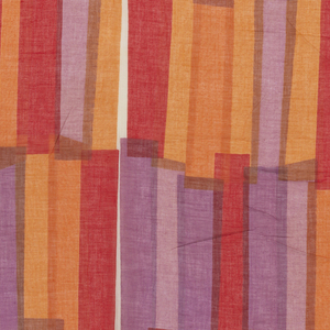 Length of semi-sheer fabric printed with overlapping strips of orange, red, brown and purple.