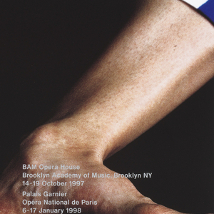 """Vertical format poster advertising dance performance of """"Scenario,"""" choreographed by Merce Cunningham with costumes by Rei Kawakubo of Comme des Garçons. On black ground, a four-color photograph detail of a dancer's body, bare calloused feet at bottom center with toes pointed outwards. At top, details of the dancer's costume, including blue and white striped pants and a checkered green and white shirt, the upper body extremely round. Printed text in gray at center and at lower right."""
