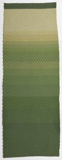 Three-dimensional woven textile with an overall geometric pattern of raised and depressed areas, in a color gradient from gray to green.