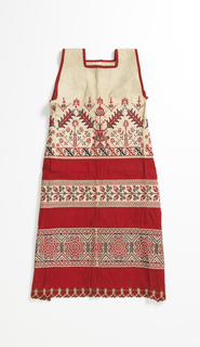 Pieces of red and ivory cotton sewn together. The areas of ivory are embroidered with a variety of geometric floral patterns in red and black cotton. The bottom is edged with coarse red and ivory bobbin lace. The neck and arm openings are bound with narrow stripes of red cotton.