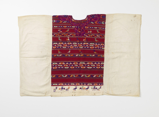 Woman's huipil in white cotton plain weave with tapestry-woven inset center panel in red with geometrical, floral designs and animals in multi-colored thread.