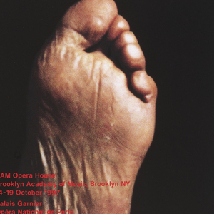 """Vertical format poster advertising dance performance of """"Scenario,"""" choreographed by Merce Cunningham with costumes by Rei Kawakubo of Comme des Garçons. On black ground, a four-color photograph of a male dancer's body, bare wrinkled feet at bottom with toes pointed upwards. At top center, view of the dancer's face. At his neck, a black v-neck outline, all other details of the dancer's costume fade into black background. Printed text in red at center and at lower right."""