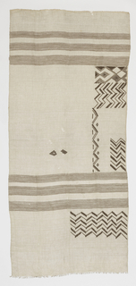 Grey panel with woven horizontal bands of brown. Embroidery along one edge in abstract geometric shapes of zigzags and diamonds.