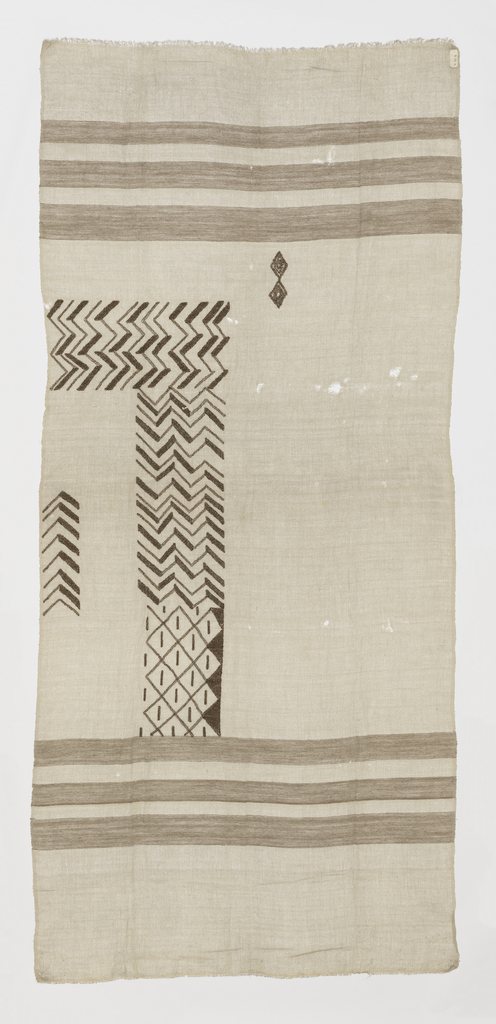 Grey panel with woven horizontal bands of brown. Embroidery along one edge in abstract geometric shapes of zigzags and diamonds. Embroidery design and spacing of bands is slightly different from 1991-155-1.