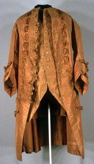 Flame-colored taffeta, trimmed with cording and tassels of same color.