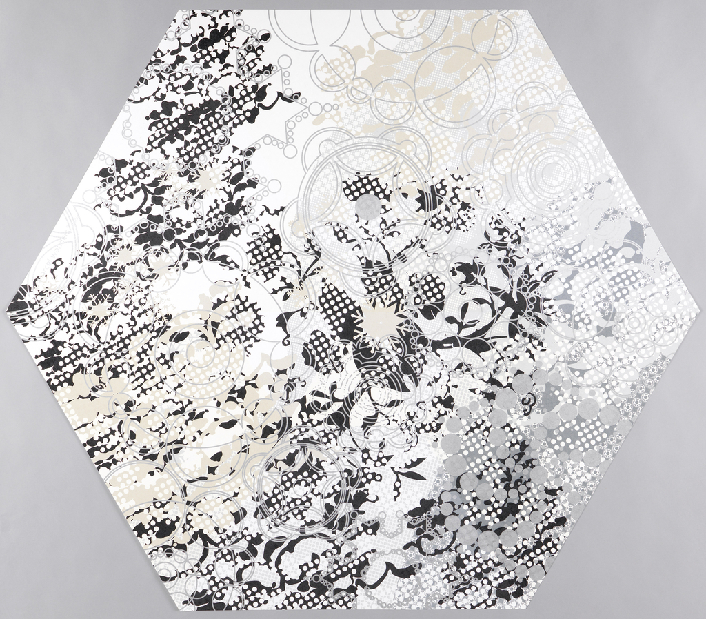 The hexagon-shaped paper is composed of multiple layers of printing containing delicate floral imagery interspersed with circular geometric shapes.  The background is composed of a grid pattern. Printed in black, gray and taupe on a white ground. The fourth of seven identical panels.