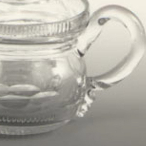 Round body with vertical fluted rim at top; loop handle; domed lid with button finial; body and lid cut with double row of printies, a row of narrow flutes at base of body.