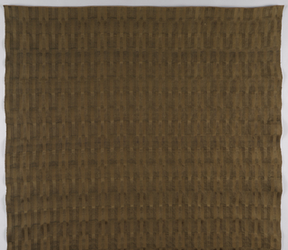 Panel in a deep brown color that is patterned by small rectangles of various twill and ribbed effects to create a variegated surface design.